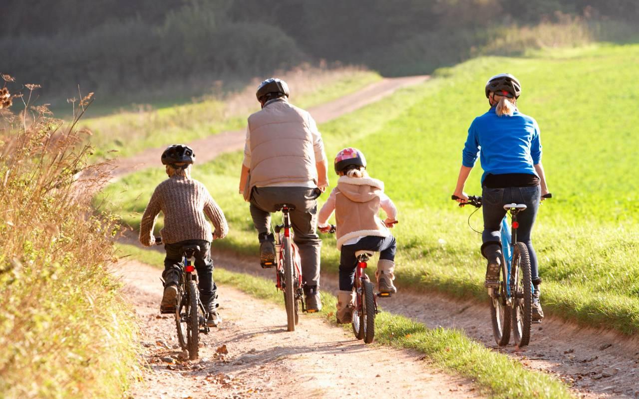 Family on bike, hotel Ile d'Oléron, Ile de Lumière