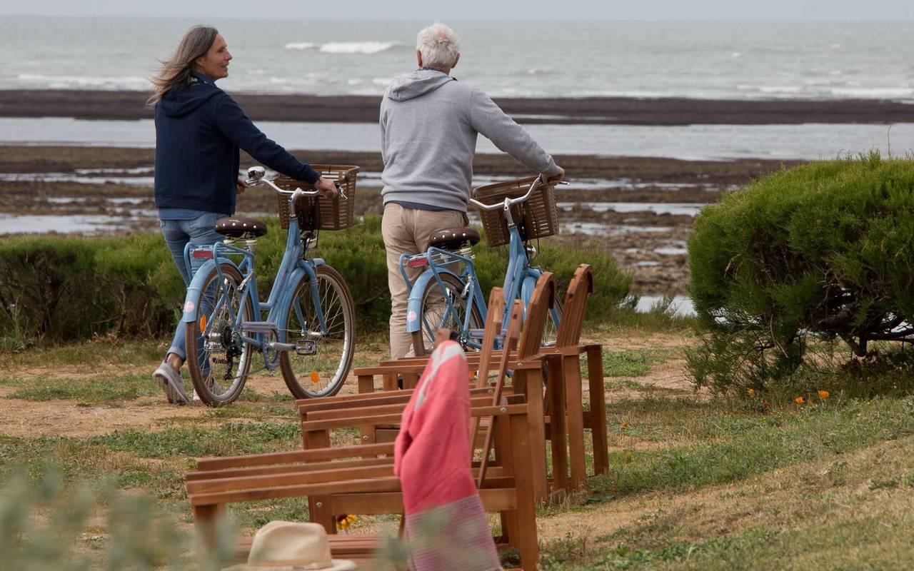 Couple riding a bicycle, boutique hotel Ile d'Oléron, Ile de Lumière